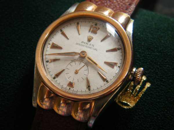 1944 'BOYS-SIZE' ROLEX OYSTER PERPETUAL SCALLOPED HOODED BUBBLEBACK REFERANCE 3801